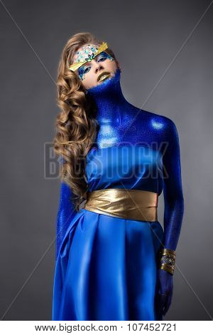 Sensual Attractive Woman In Blue Glitter Dress, Rhinestones On Face, Standing, Grey Background