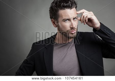 Handsome Young Man Wearing Grey Suit
