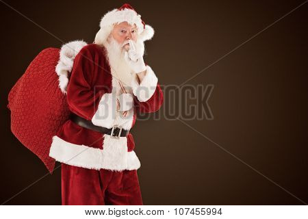 Santa asking for quiet with bag against dark brown background