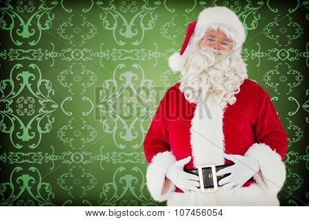 Santa claus holding his belly against elegant patterned wallpaper in red and gold
