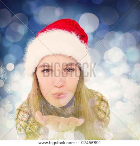 Happy hipster blowing kiss against snowflake pattern
