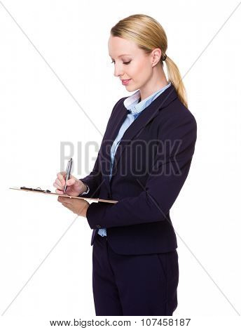 Caucasian Young Businesswoman write on clipboard
