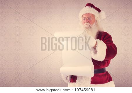 Santa Claus reads a list against room with wooden floor