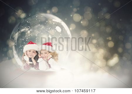Festive child in snow globe against black abstract light spot design