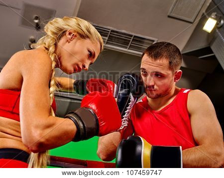 Couple Man and  Woman Wearing Gloves Boxing in Ring. Fitness trainer.