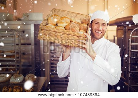 Snow against baker holding basket of bread