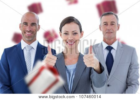 Business colleagues smiling at camera against white and red gift box