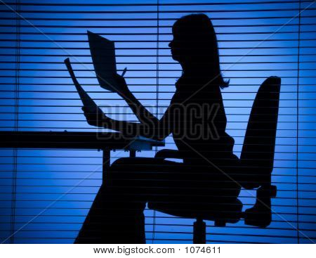 Silhouette Of Woman With Papers