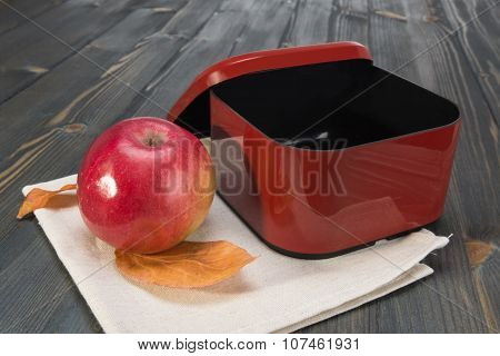 Red Apple And A Open Empty  Box For School Lunch