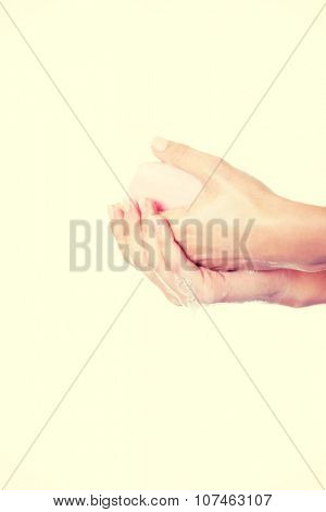 Beautiful woman hand washing her hands with soap