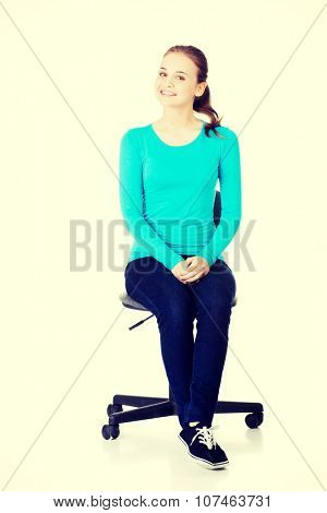 Young happy student woman or businesswoman sitting on a wheel chair