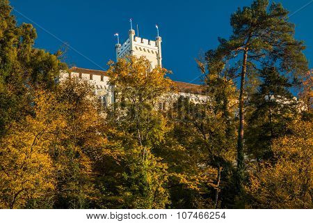 Roof of the Castle of Trakoscan above trees on hill in autumn, Zagorje, Croatia