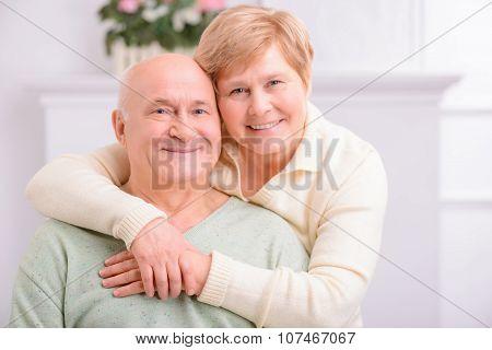 Adult loving couple embracing