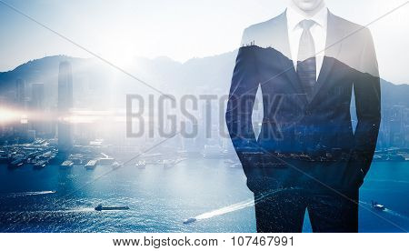 Multi exposure of young business man in the modern city on background