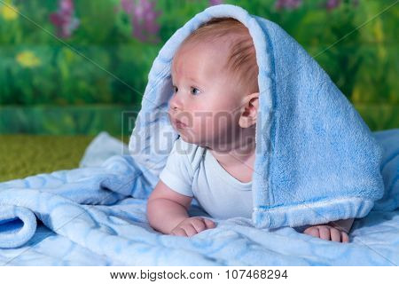 Portrait Of A Baby In A Blue Towel.