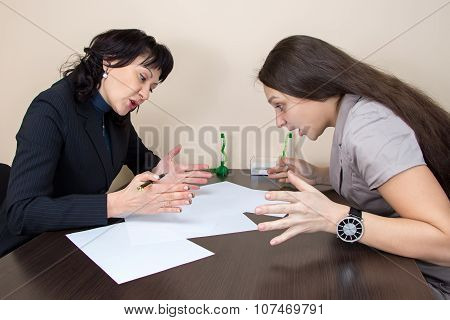 Business lady sitting in office and talking