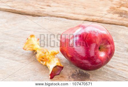 Red Apple And Apple Core On A Wooden Background