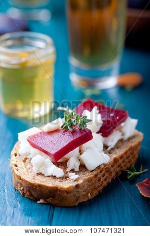 Crostini, bruschetta with plum, berry marmalade and goat cheese
