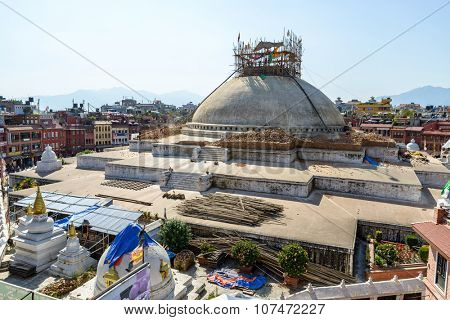 KATHMANDU, NEPAL - OCTOBER 3, 2015: After experiencing structural damages due to the April 25th earthquake, the top of Boudhanath stupa is being dismantled. It will be reconstructed as before.