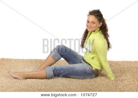 Young Woman On The Soft And Comfortable Carpet