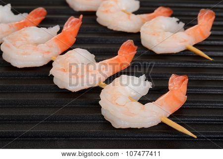 closeup shrimp skewers on grill
