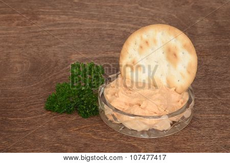 dish of salmon pate with parsley on wood