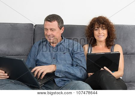 Happy And Lovely Couple On Sofa