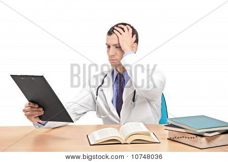 A View Of A Doctor Banging His Head Realizing A Mistake
