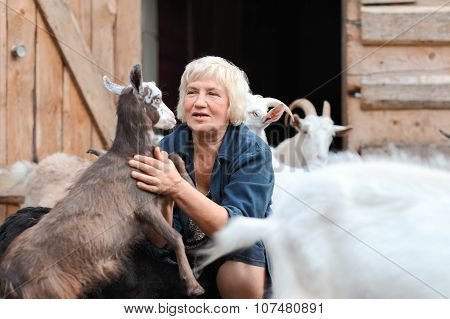 Woman farmer with goats