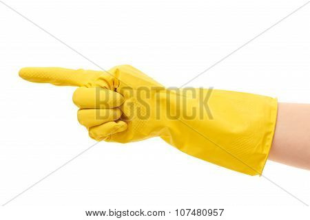 Close up of female hand in yellow protective rubber glove pointing on something