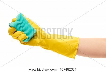 Close up of female hand in yellow protective rubber glove holding green cleaning sponge