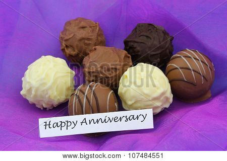 Happy Anniversary card with assorted chocolates, pralines and truffles
