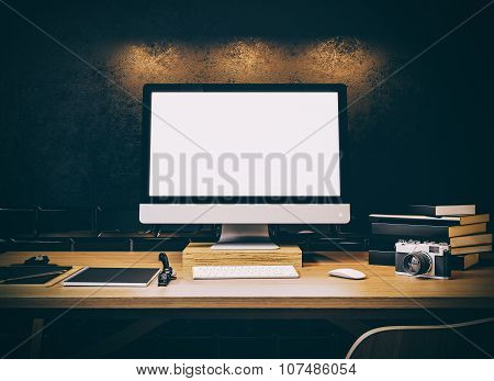 Photo of generic design computer screen on the table. Workspace