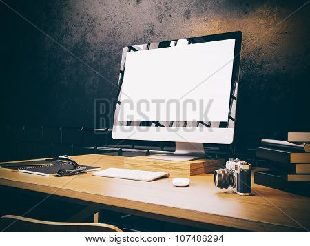 Photo of generic design computer screen on the table. Workspace. Horizontal