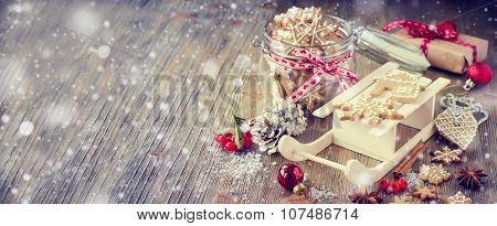 Christmas gingerbread cookies, vintage festive rustic table decoration with gift box copy space