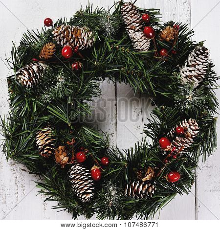 Christmas Wreath With Pinecones On Wooden Background