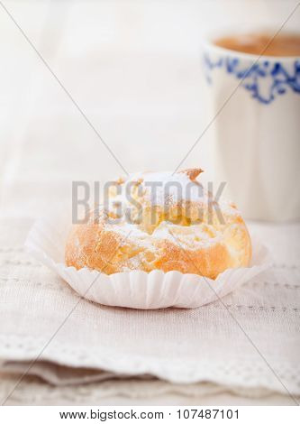 Profiteroles, choux with a custard cream. Dessert