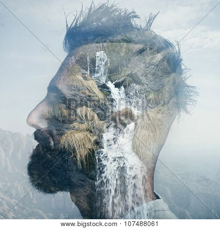Double exposure portrait of a man into the wild nature