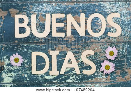 Buenos dias (Good morning in Spanish) with pink daisies