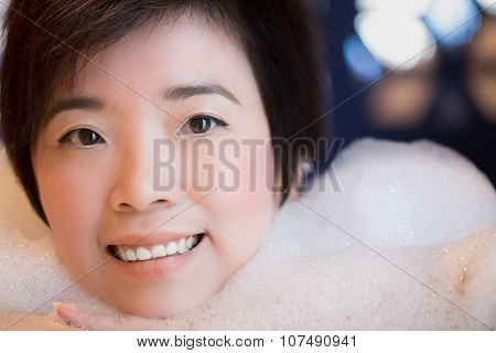 Close-up Of Beautiful Young Woman Takes Bubble Bath : Selective Focus
