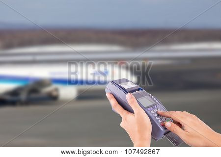 Hand With Credit Card Swipe Through Terminal For Sale Airplane Ticket
