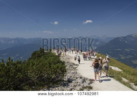 BERCHTESGADEN, GERMANY - AUGUST 13, 2015: People walking to the summit cross on top of the Kehlstein Obersalzberg close to Berchtesgaden in Bavaria