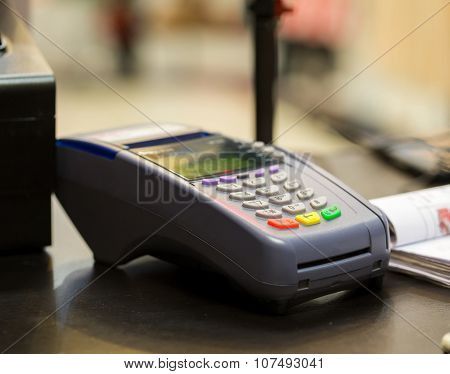 Credit Card Machine On Cashier Counter In The Store