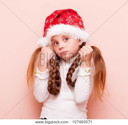 Girl With Pigtails In Santa Claus