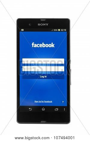 Smartphone Sony Xperia Z And Facebook Page Isolated On White