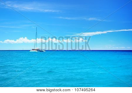Sailing Party Catamaran In The Blue Carribean Sea And Cloudscape