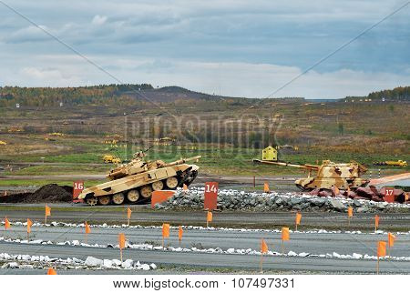 Modernized Main Battle Tank T-90S On Obstacle Springboard Wall