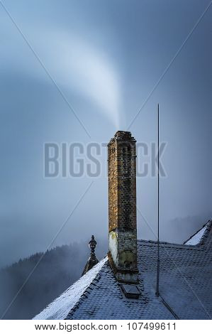 Smoky Chimney In Winter