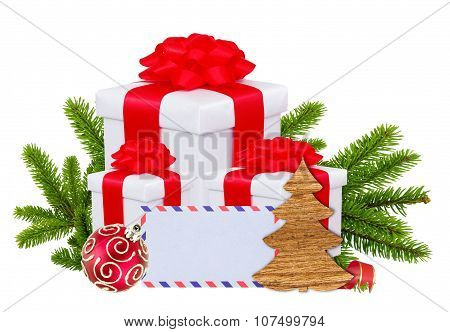 Christmas Gift Boxes, Decoration Balls And Tree Branch Isolated On White