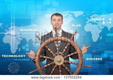 Man with steering wheel and business words